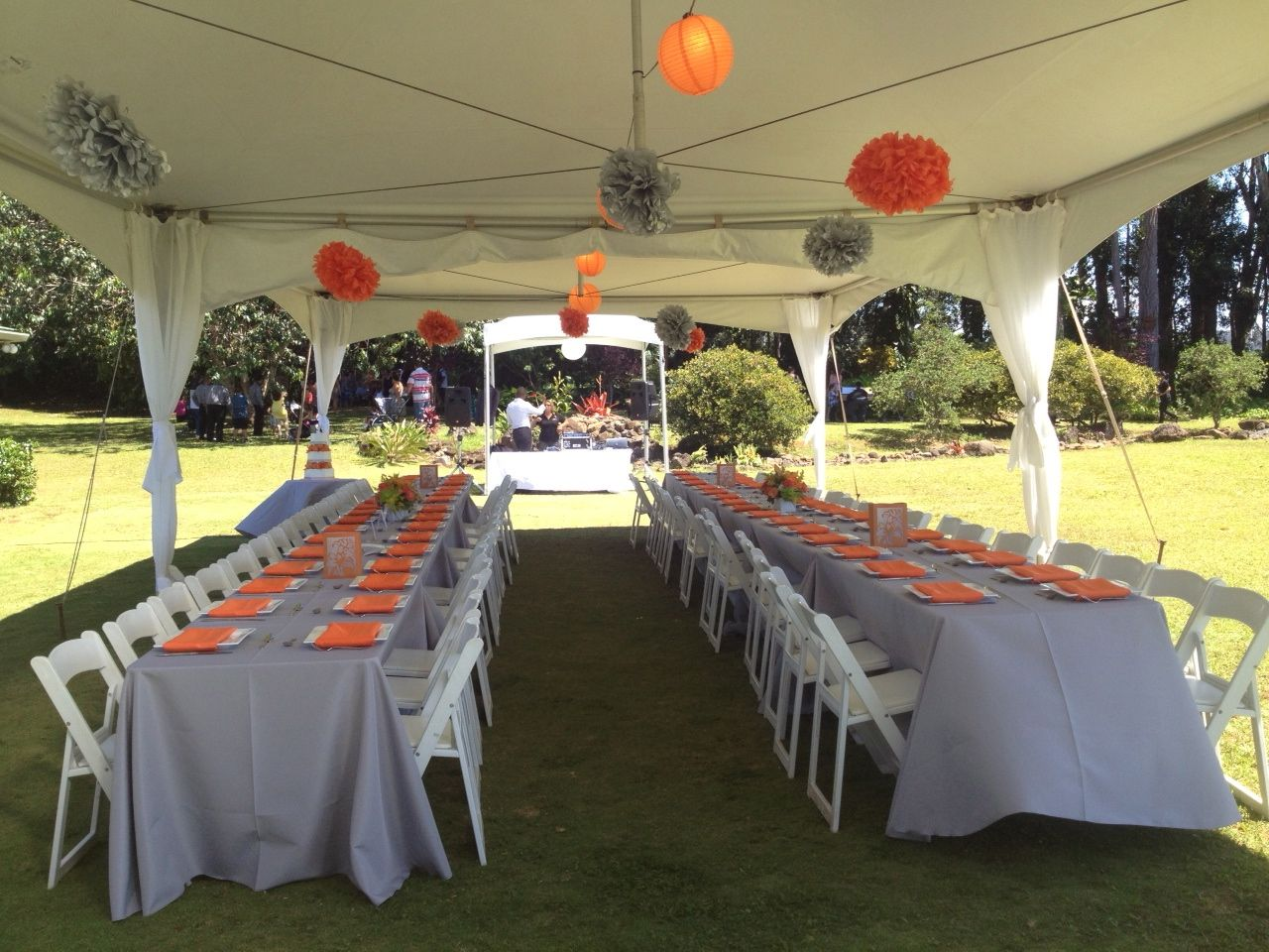 Silver And Orange Table Settings On Long Rectangle Tables With White Resin Chairs 20x40