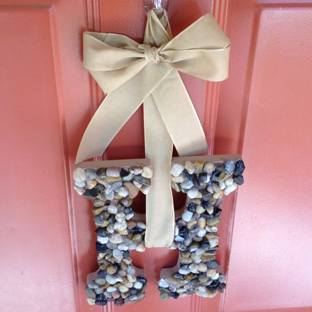 Wooden letter monogram with little rocks! Add some ribbon and makes for a great decoration for the front door in place of a wreath!