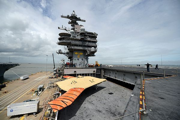 NORFOLK (May 6, 2013) An X-47B Unmanned Combat Air System (UCAS) demonstrator is lowered on an aircraft elevator from the flight deck of the aircraft carrier USS George H.W. Bush (CVN 77).