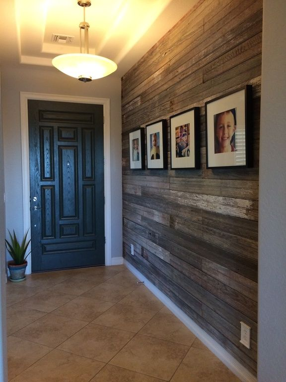 Unique Foyer Flooring : Entry with unique door and wood wall entryways