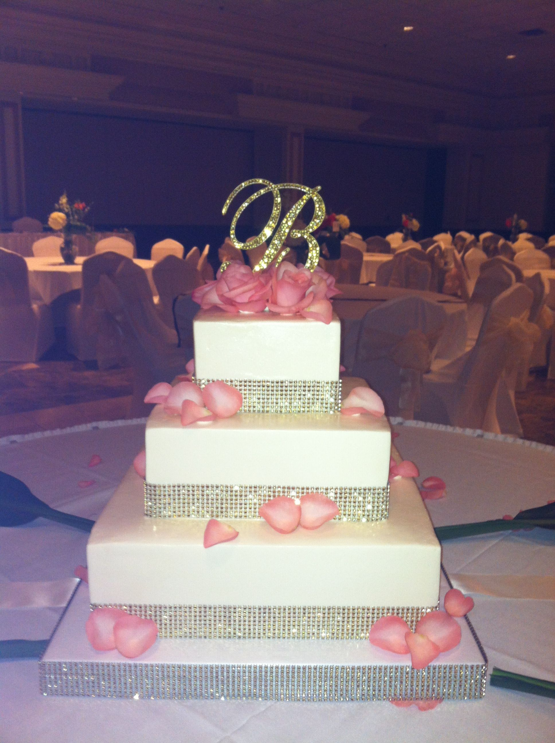 Gold Bling Wedding Cake With Coral Roses And Rhinestone Initial
