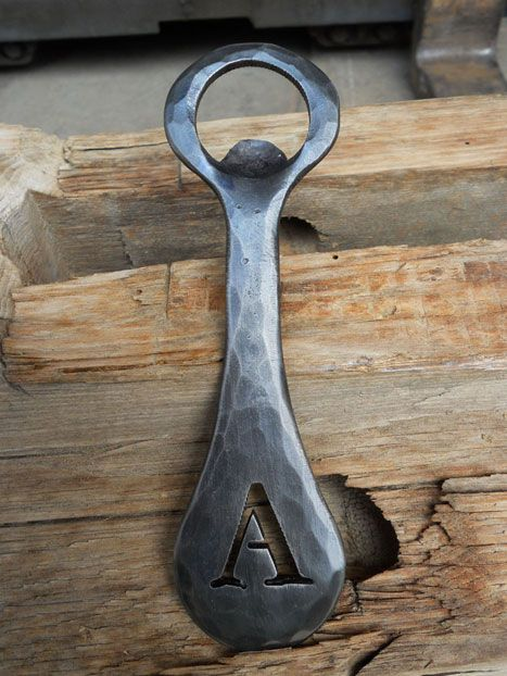 BOTTLE OPENER: This handmade design by American Forge South is the ultimate tailgating accessory.    $75; 404-351-8324