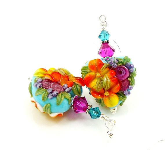 Hey, I found this really awesome Etsy listing at http://www.etsy.com/listing/152679902/turquoise-orange-pink-earrings-heart