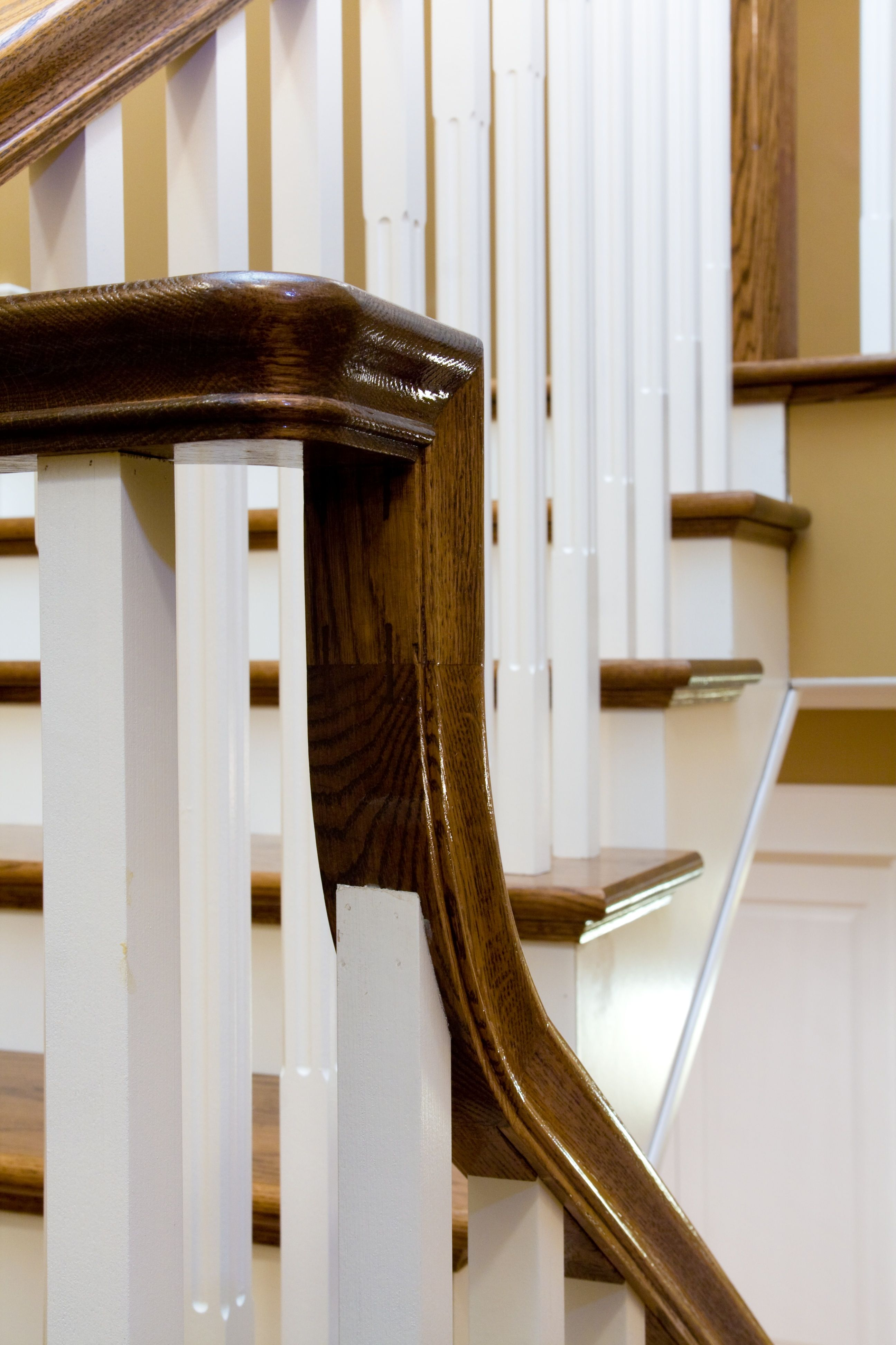 Distinctive Interiors   Dark Solid Wood Handrail And Treads With White  Spindles And Risers Makes A