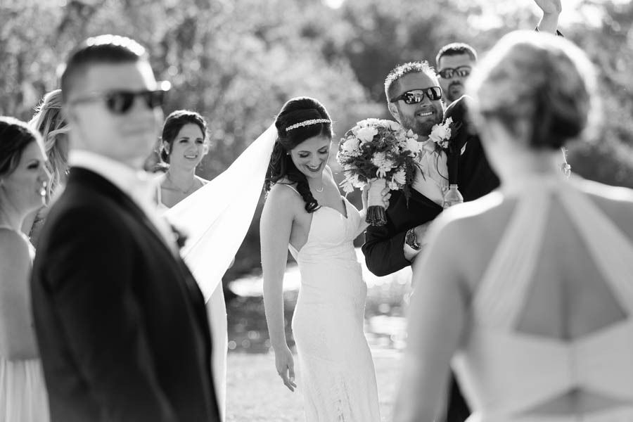 Black And White Bride And Groom Candid Wedding Portrait Celebrating