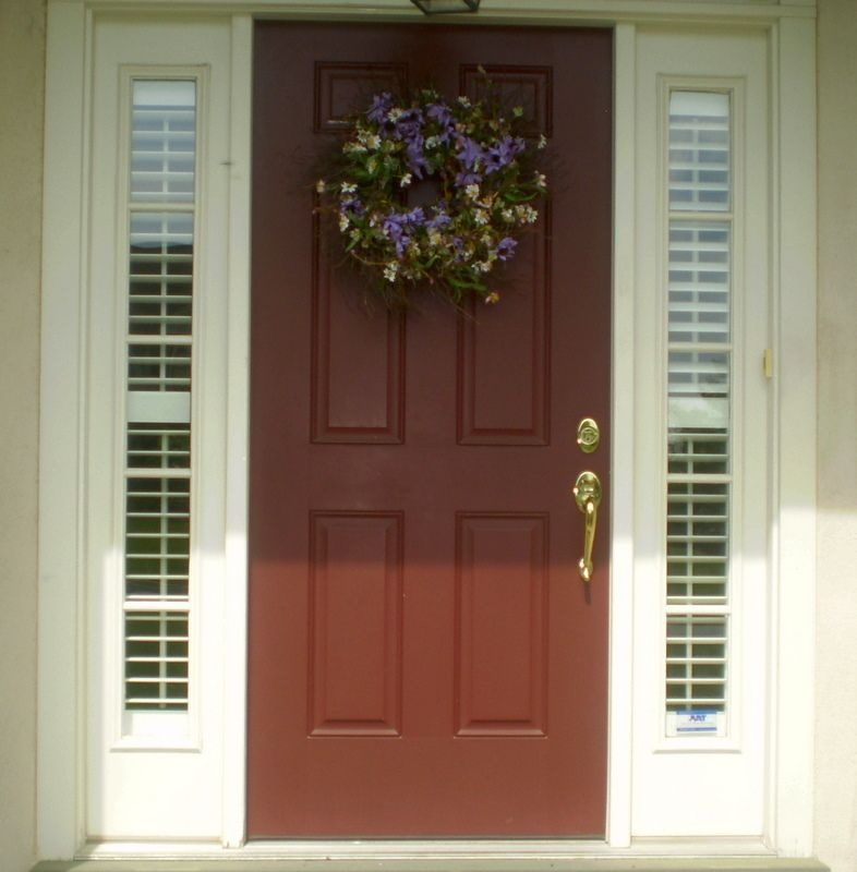 Plantation shutters for sidelights home and hearth for Front door window curtains