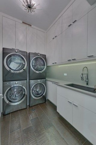 Luxury Laundry Room Featuring Dual Washer And Dryers Laundry