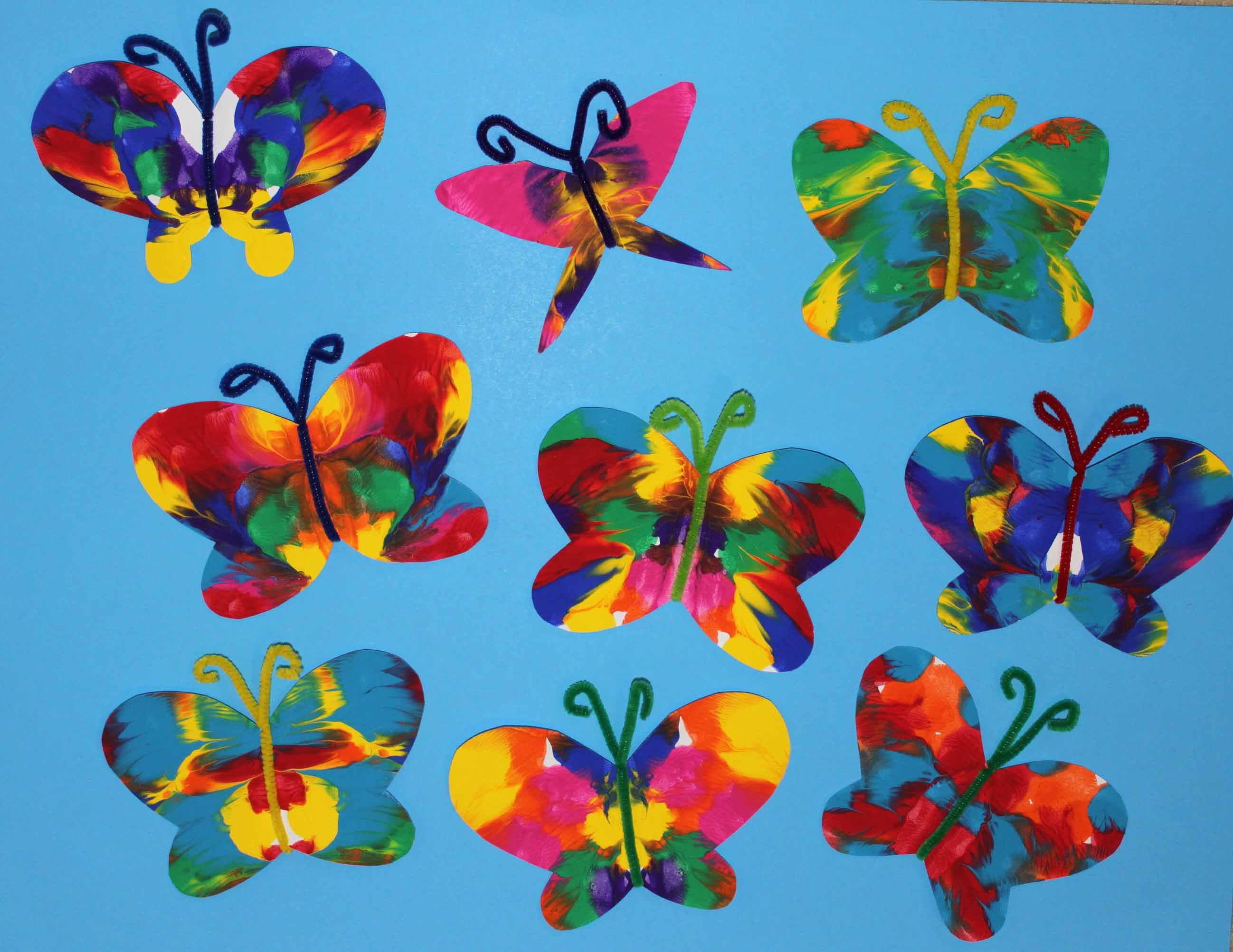 Symmetrical Painted Butterfly Craft | Butterfly crafts, Spring ...