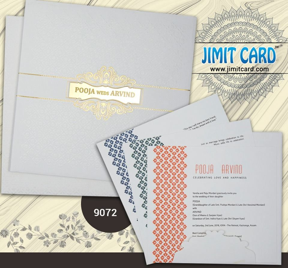 A Beautiful Elegant White Weddingcard With Self Pattern Design
