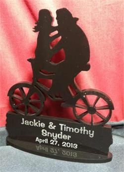 Having a bicycle themed wedding? Order a kissing couple wedding cake topper, http://www.best-engraving.com/Bike_Themed_Wedding_Couple.aspx