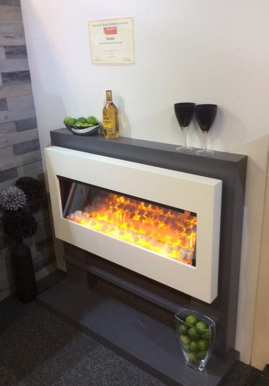 The Tequila Suite featuring the stunning Flamerite Omniglide electric fire. This suite made the top 3 in the finals in the electric suite category at the Hearth and Homes at Harrogate Show 2015. #electric #fireplace #electricfire #york #firesuite