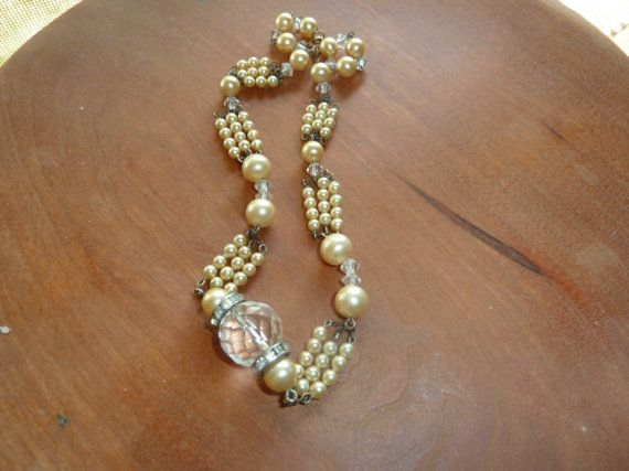 Hey, I found this really awesome Etsy listing at http://www.etsy.com/listing/105431304/vintage-faux-pearl-and-gemstone-necklace