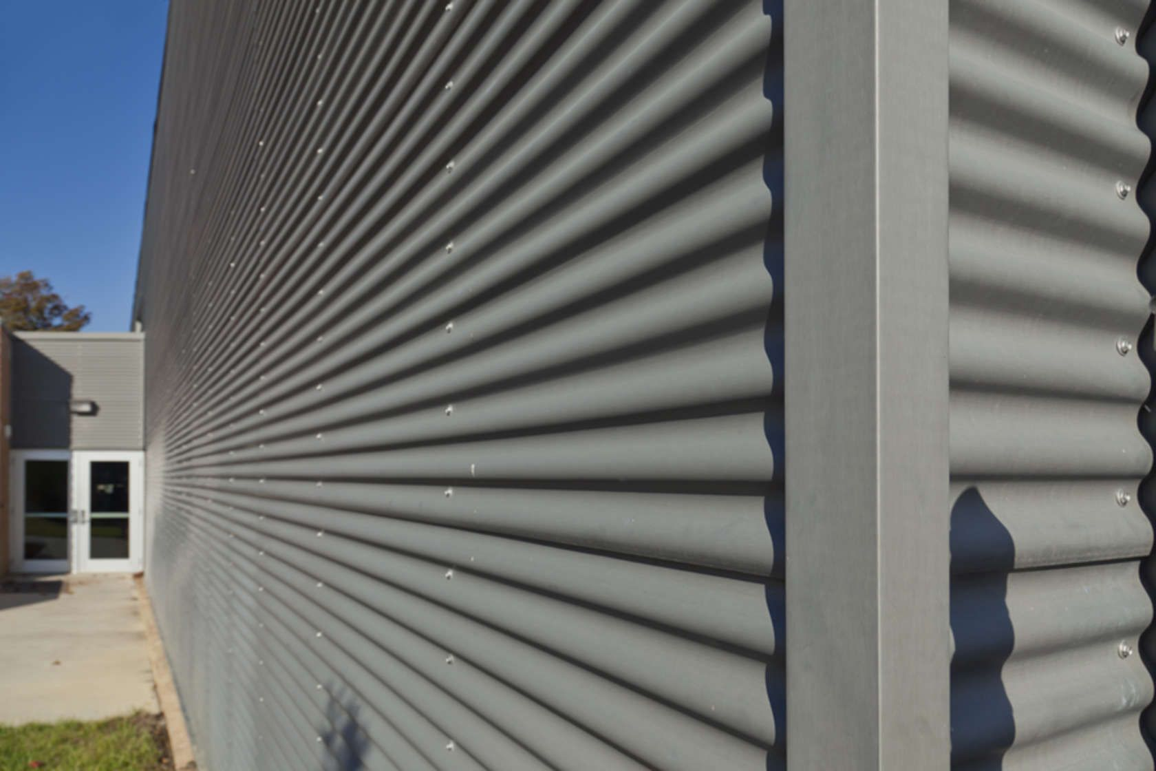 Vmzinc S Corrugated Wall Panels Belong To The Rain Screen Family Wall Cladding Installed On A Ventilated Air Space Corrugated Wall Corrugated Roofing Cladding