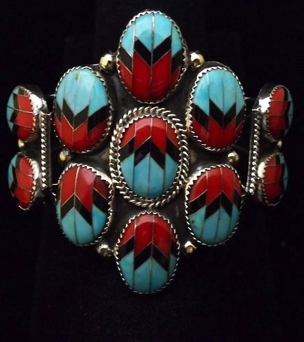 Inlaid turquoise, coral and onyx bracelet.