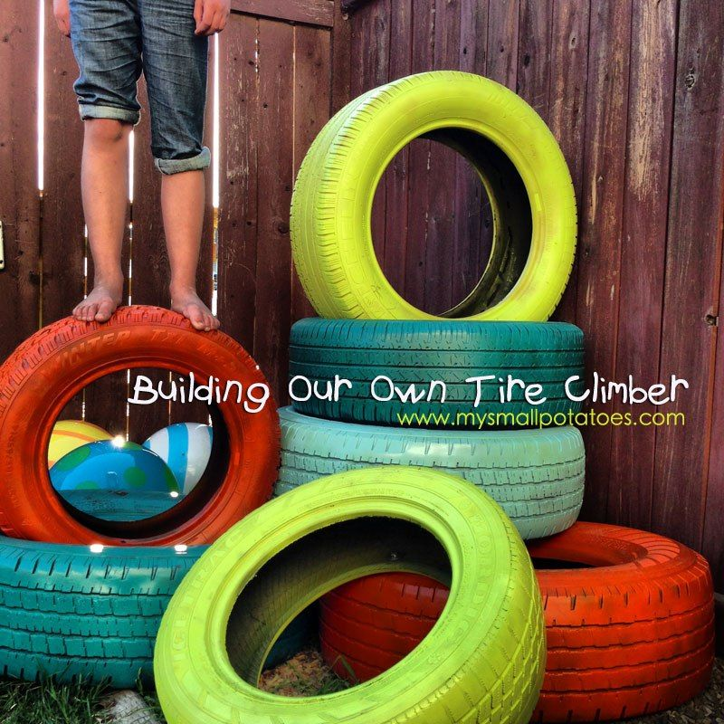Build a fun and color tire tower for climbing in your own for Tire play structure