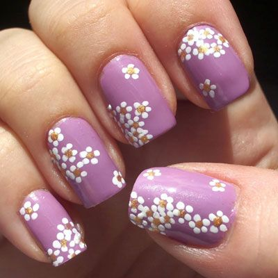 Some flower designs can look overwhelming, and even more overwhelming to  try and copy! This design looks simple without being boring - Spring 2012 Nail Trends: Simple Flowers Nails By Jordyn Hetland