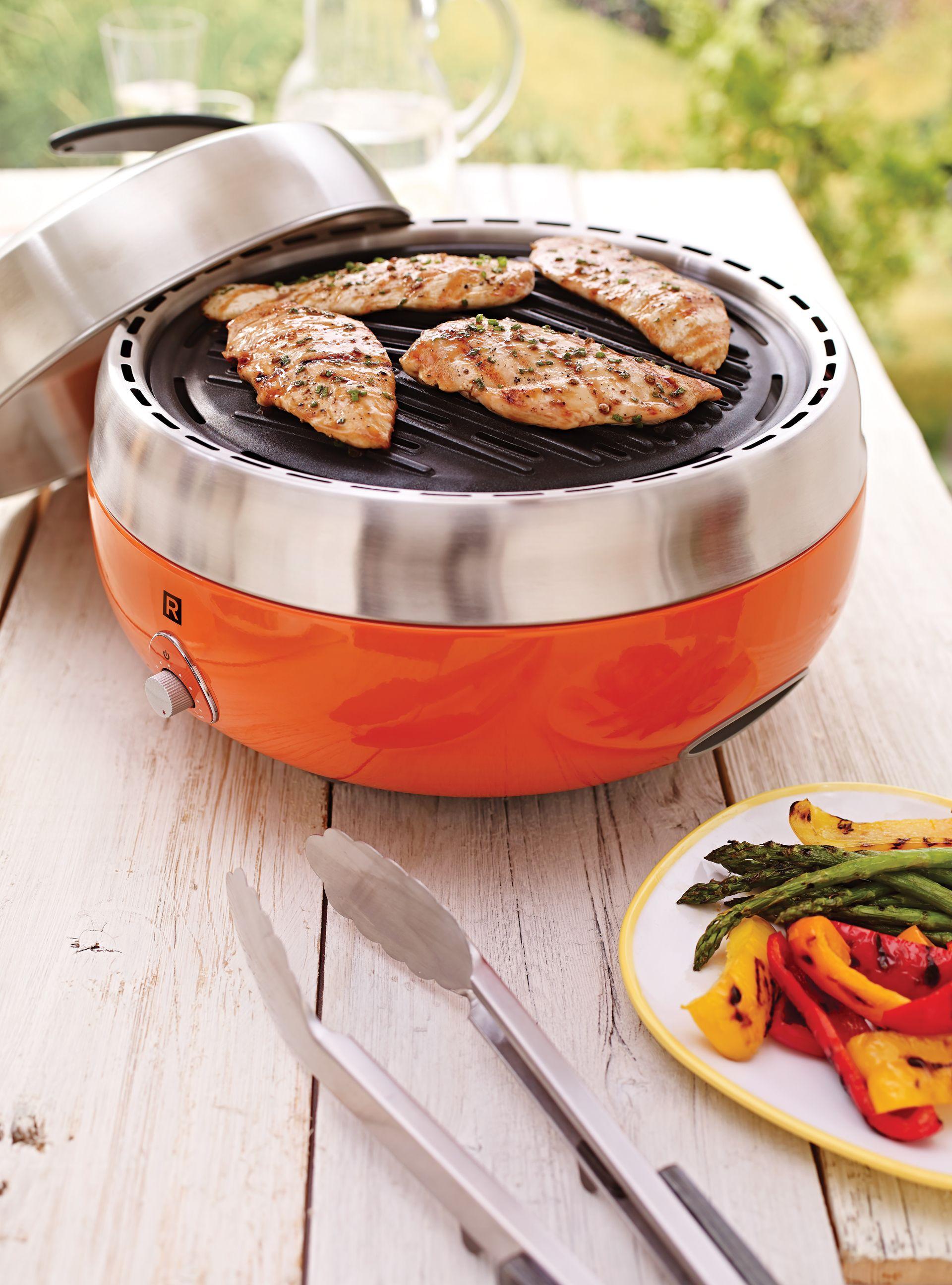 Barbecue portatif - Au charbon de bois, il s'utilise autant à l'extérieur qu'à l'intérieur.