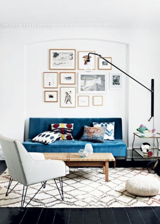 Teal sofa in a stylish modern living room via Thou Swell @thouswellblog