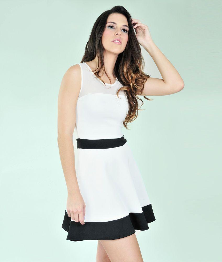 0dc6d2576 Vestido blanco con franjas negras.