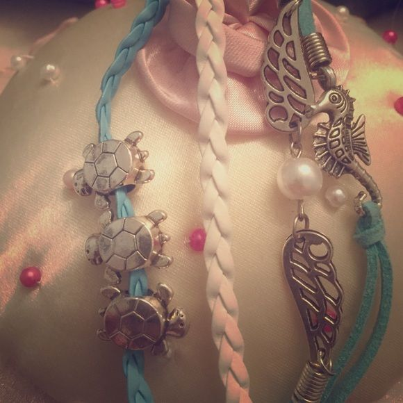 """Bundle HelperOcean themed bracelet   Lowest Mark Down Available  Four strand bracelet features sea turtles, a winged pearl, and a sea horse. Light blue and white bands with sliver clasp. 8"""" long Jewelry Bracelets"""