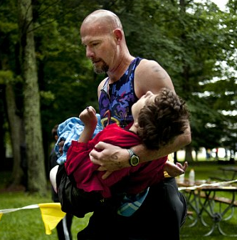 One Amazing Father Finishes A Triathlon…Carrying His Daughter With Cerebral Palsy Across The Finish Line