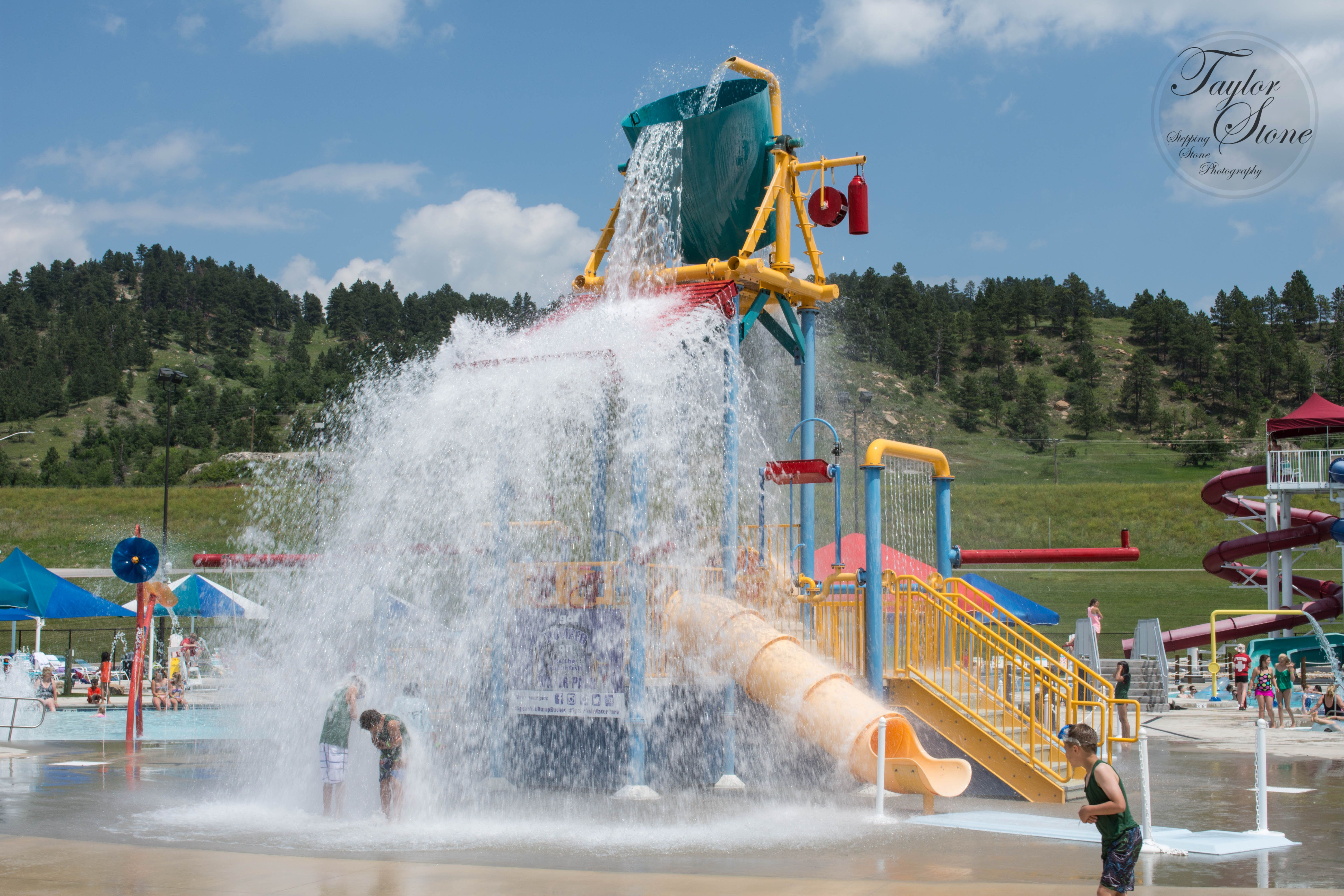 The 400 gallon dump bucket dumps out every few minutes spraying water across the area at the Spearfish Rec & Aquatic Center!