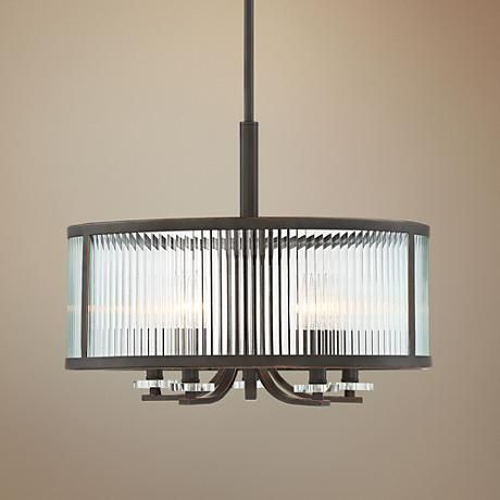 Ribbed glass creates dimension and a mesmerizing effect in this lovely oil-rubbed bronze chandelier.