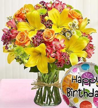 """Fields of Europe™ Happy Birthday Bouquet- roses, lilies, alstroemeria, poms, waxflower, monte casino and salal with 18""""D Mylar """"Happy Birthday"""" balloon."""