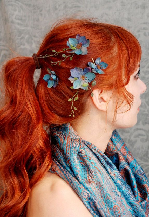 Love the contrast of her red hair and those blue flower accessories ...