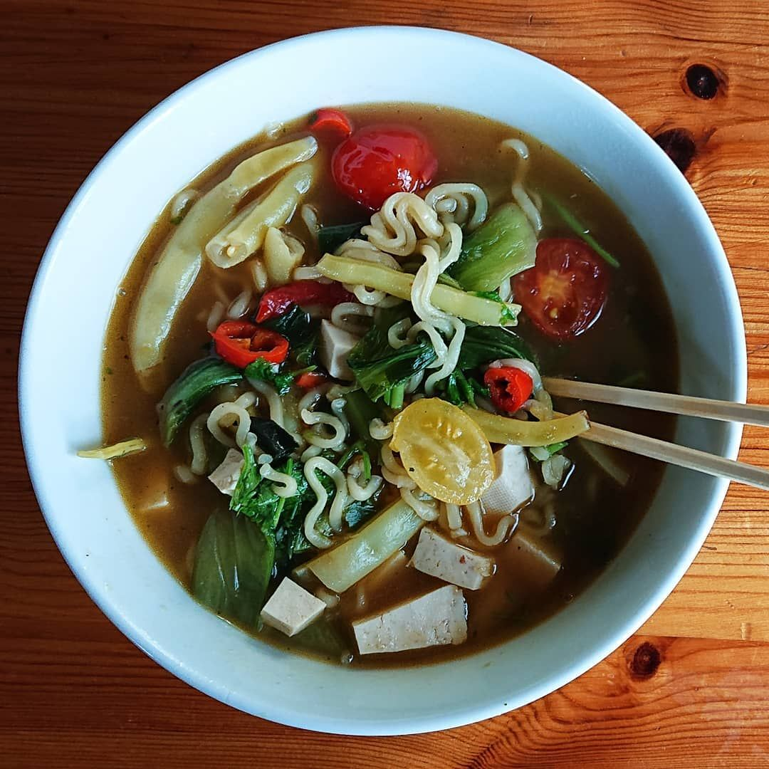 Tom Yum-inspired noodle soup with home grown veggies. . . .