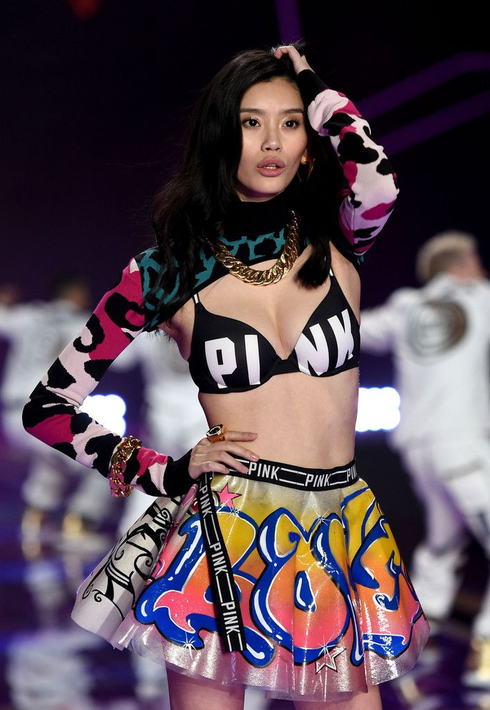 27fd744d5f Model Ming Xi walks the runway during the 2014 Victoria s Secret Fashion  Show at Earl s Court Exhibition Centre on December 2