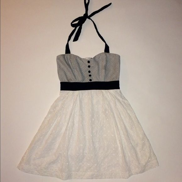 Pinstriped halter top dress w/white eyelet bottom Adorable halter sundress! Top is pinstriped with button detailing. Black waistband detail. White eyelet bottom.  Fit and flare style, back zipper.   Pinstripes are a dark grey( looks  black from afar) Dresses