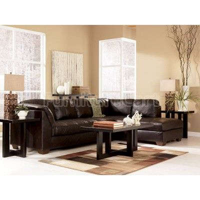 Harrington  Chocolate Sectional Living Room Set is part of Chocolate Sectional Living Room - Leather Match upholstery feature topgrain leather in the seating areas with skillfully matched vinyl everywhere else  Leather Match upholstery in Harrington Living Room Collection by Signature Design by Ashley Furniture, offers the luxurious look and feel of top quality leather with the benefit of protection  This contemporary design features the comfortable feel of plush pillow arm pads, boxed back pillows and quilted bench seating perfect for any relaxing living room environment  The smooth leather surface offers a clean uniform look while the subtle twotone effect enhances color depth and vibrancy