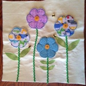This is the XL version of the flower page. All four flowers button on. What a lot of fun.