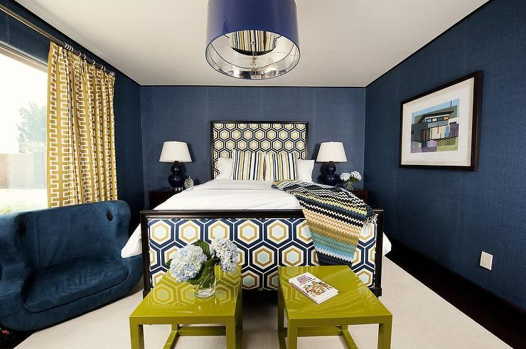 Yellow And Blue Bedroom Features Walls Clad In Navy Textured Wallpaper Lined With Bed With Headboard Blue And Gold Bedroom Gold Dining Room Blue Bedroom Walls