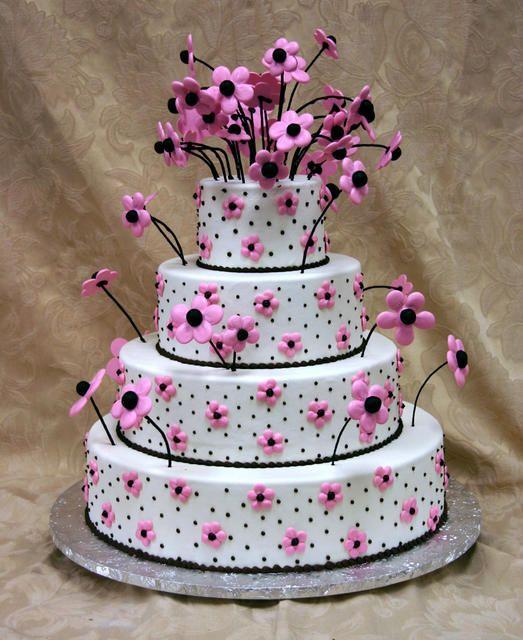 Whimsical pink-and-black daisy wedding cake