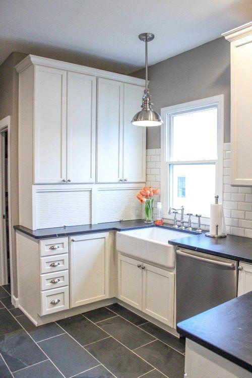 Black soapstone Kitchen with white subway tile backsplash ...