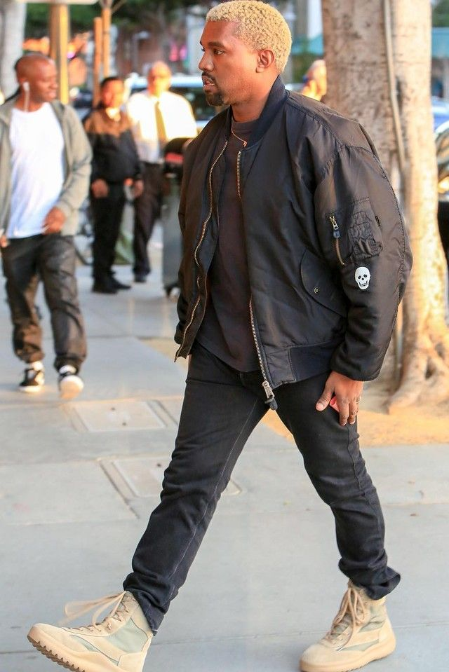 online store 71a34 66436 Kanye West wearing Yeezy Season 5 Military Boots, Raf Simons S S 2000  prototype black palms bomber