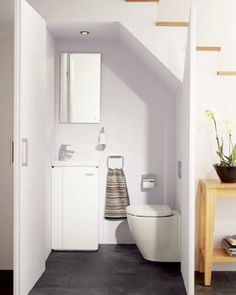 tiny powder room under stairs
