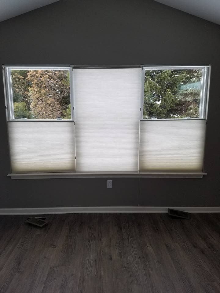 A Cellular Shade is a great insulating window covering & unique with the top-down feature.