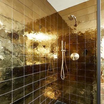shiny gold shower tiles with black grid floor tiles | gold