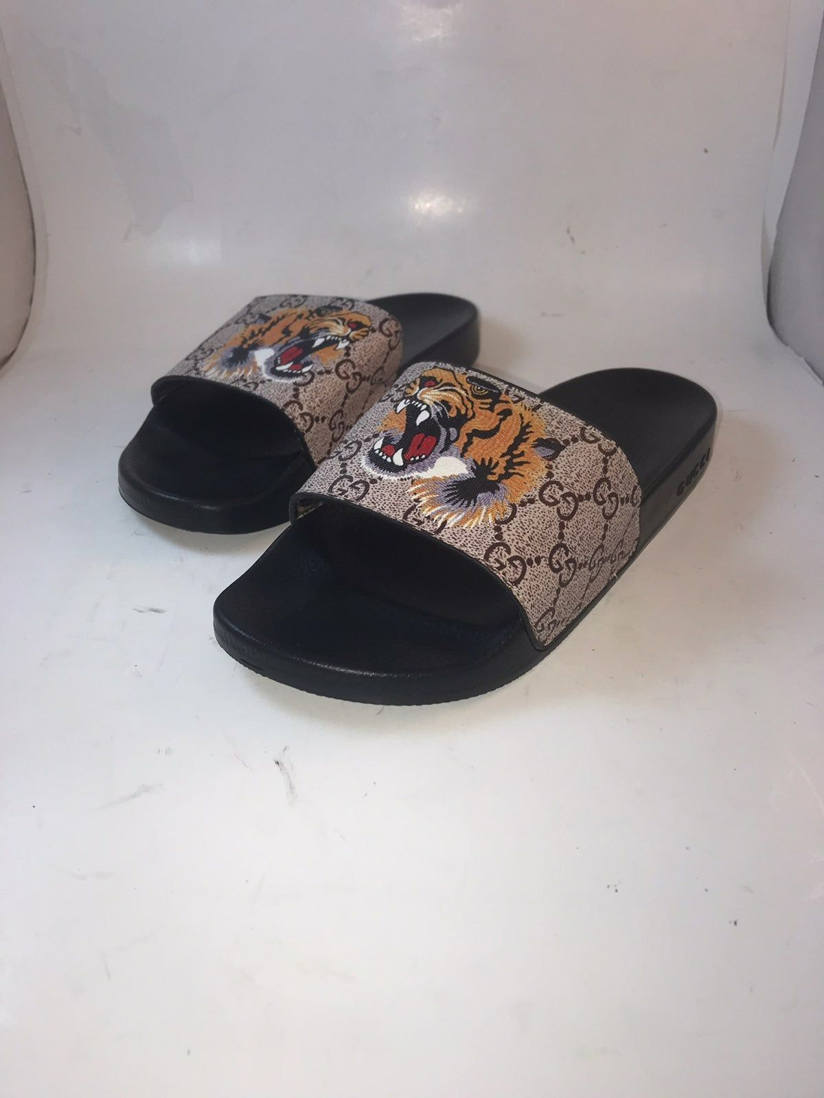 These pre,owned Gucci Supreme Tiger Slides Sandals Are in