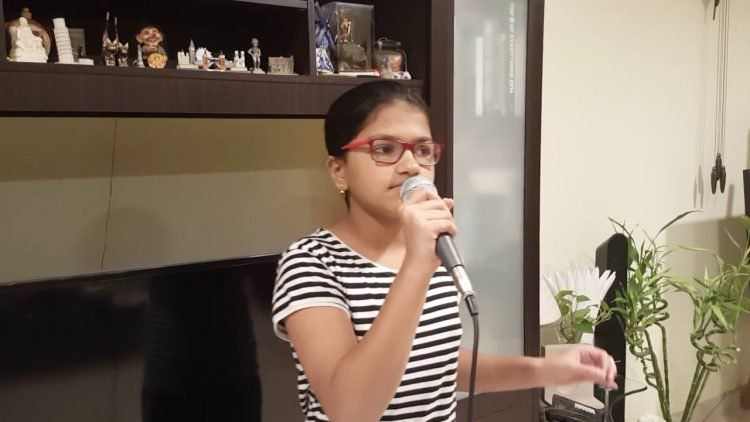 12yearold girl sets two new world records for singing in