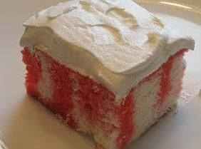 Strawberry jello poke cake with Cool Whip topping  - Desserts -