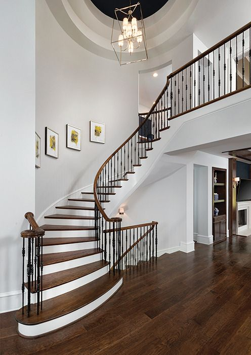 Welcome Home! Pictures that wind up a staircase guide the eyes