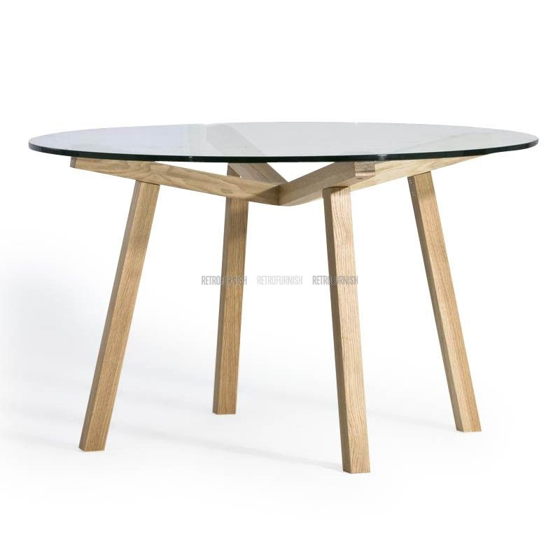 The Forte Round Table Has A Round Shaped Top Made Of Glass Or Wood - Glass or wood dining table