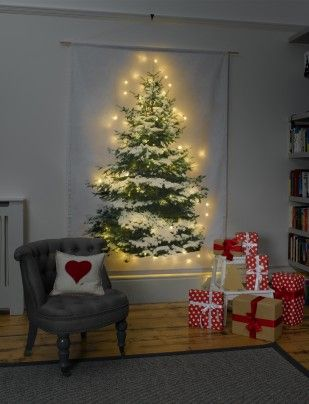 The snow-dusted Christmas Tree Wall Hanging from Betsy Benn Designs is digitally printed on cotton fabric and features a dowel-pocket at the top for hanging ($123, www.betsybenn.co.uk).
