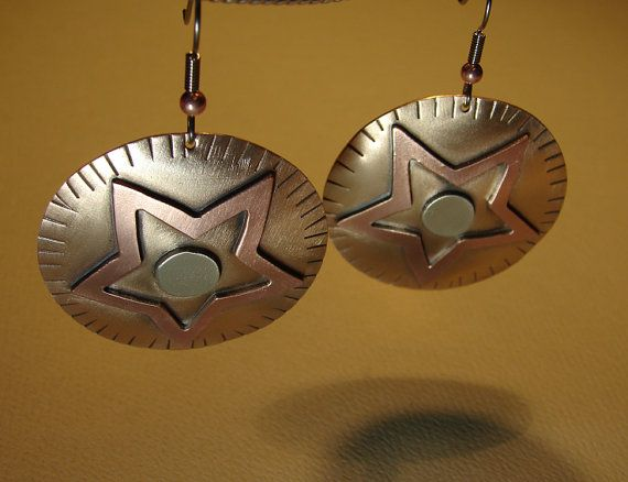Medley of metals earrings with copper star on bronze by NiciLaskin, $75.00