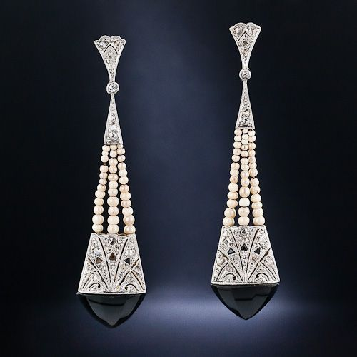 A fun and feminine pair of earrings from the early-Art Deco era. Delicate rose-cut diamonds are set into these platinum over gold earrings which features three rows of seed pearls, onyx calibre and a faceted onyx at the base.