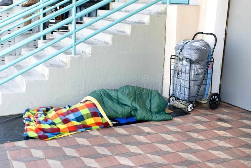 Homeless person sleeping a homeless person sleeping along